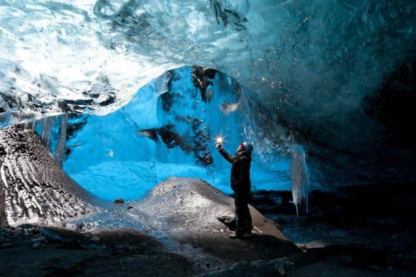 ***EXCLUSIVE*** VATNAJOKULL GLACIER, ICELAND - UNDATED: Rob Lott stands under the crystal ice cave in the Vatnajokull Glacier, Iceland. SHIMMERING clearest blue and stretching as far as the eye can see, this is one of Iceland's famed crystal ice caves. The giant solid waves look frozen in time but they are slowly moving along as part of the Vatnajokull Glacier - which stretches across eight per cent of the island. The images were captured in February 2014 by British photographer Rob Lott, 49. PHOTOGRAPH BY Rob Lott / Barcroft Media UK Office, London. T +44 845 370 2233 W www.barcroftmedia.com USA Office, New York City. T +1 212 796 2458 W www.barcroftusa.com Indian Office, Delhi. T +91 11 4053 2429 W www.barcroftindia.com